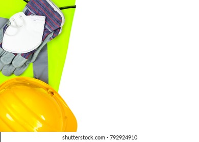 Yellow hi vis vest and hard hat with safety gloves and a dust mask isolated on a pure white background