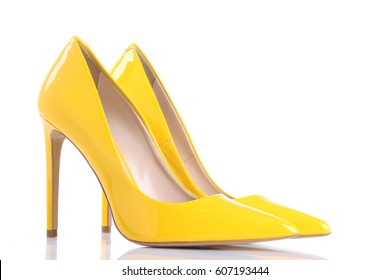 Yellow high heel women shoes on white background