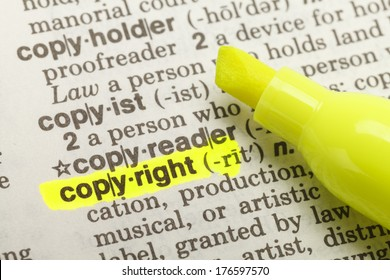 Yellow Highlighter And Marked Copyright Dictionary.