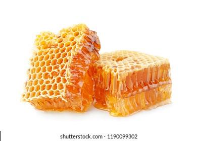 Yellow Honeycomb slice closeup isolated on white background