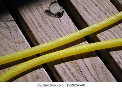 Yellow Hose on a Wooden Surface