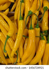 Yellow hot peppers on display at supermarket.