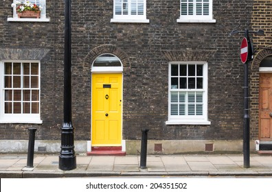 Yellow house door on a London street