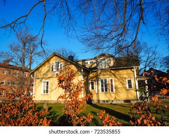 Yellow house in the garden with navy blue sky background, Karlstad, Sweden 19 Feb 2016