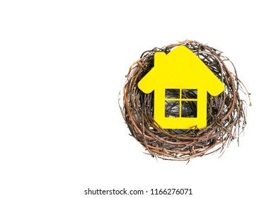Yellow house in the nest on isolated background.Top view
