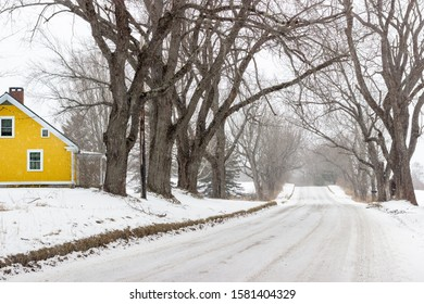 Yellow house in the snow