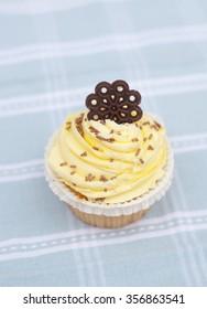 Yellow icing cupcake