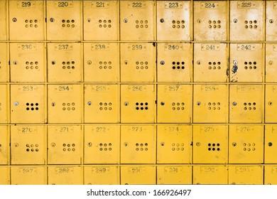 Yellow individual metal postal boxes in Mauritius