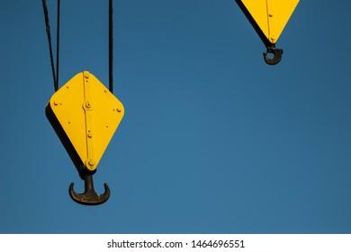 Yellow industrial crane lifting hook