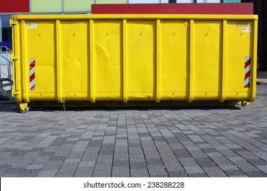 yellow industrial garbage skip