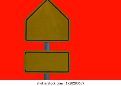 Yellow iron signposts on red background