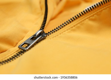 Yellow jacket with zipper as background, closeup view