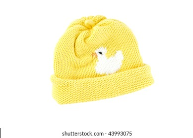 A yellow knit winter baby hat, isolated on white background, horizontal with copy space