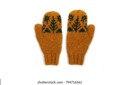 Yellow knitted mittens. Handmade. Isolated. View from above.