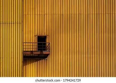 Yellow ladder with yellow railing, colored background, structure of stairway in industrial factory
