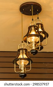 Yellow lamps with glass structure on ceiling in ballroom