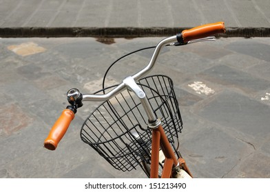 Yellow leather grip, black bicycle bell and front basket