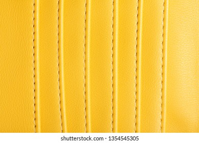 Yellow leather small wallet pockets texture.