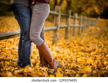 Yellow leaves, fall season, legs, couple in love, boots, fence background
