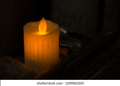 yellow LED candles in the dark