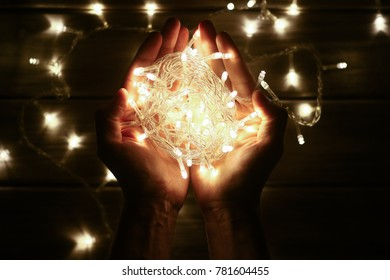 Yellow LED garland in hands