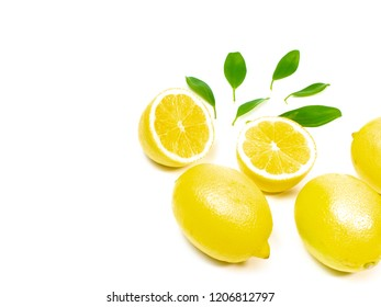 yellow lemon with green leaves on a white background