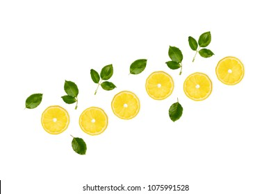 Yellow lemon slices and leaves isolated on white background, top view. Citrus vitamin c concept, summer bright composition.