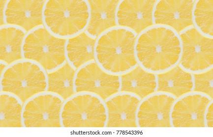 Yellow lemon slices pattern texture background.