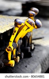 Yellow levers and switches to operate equipment
