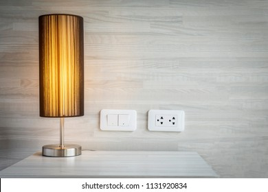 Yellow light decoration in bed room with switch and electric plug connector - bed room background concept