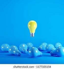 Yellow Lightbulb floating among blue lightbulb on background. minimal idea concept.