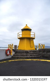 Yellow lighthouse on harbor in Reykjavik,Icleand.