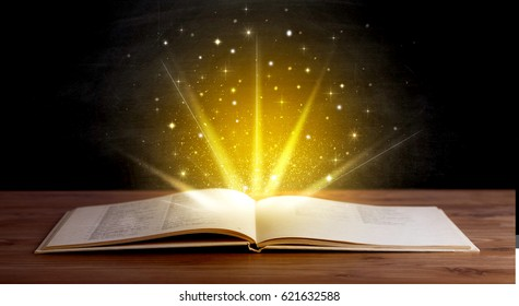 Yellow lights and sparkles coming from an open book