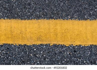 yellow line on the asphalt road texture