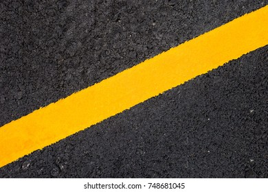 yellow line on asphalt road