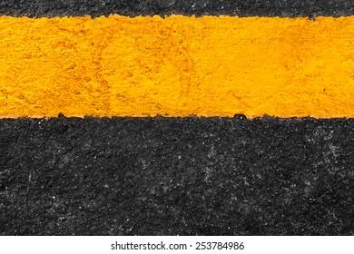 Yellow line on asphalt texture