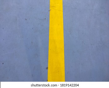 Yellow line on gray concrete floor
