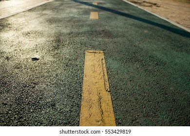 yellow line on the green road