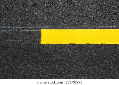 Yellow line on new asphalt
