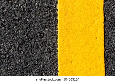 Yellow line on new asphalt detail,Street with yellow line texture
