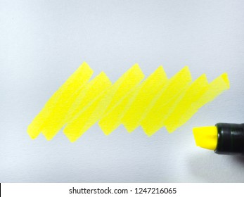 yellow line on paper, yellow highlighter on white paper background.