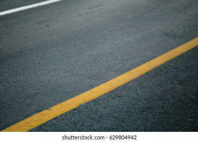 yellow line on the road texture, asphalt as abstract background