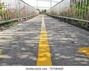Yellow line of overpass walk away follow arrow right left.