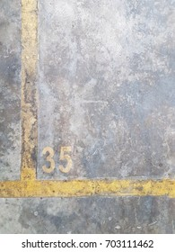 Yellow line parking spot with number 35