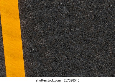 Yellow Line Printed On The Road