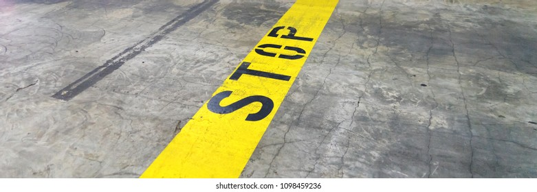Yellow line with text STOP in the underground car park