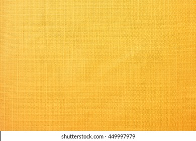 Yellow linen fabric of table cloth texture background
