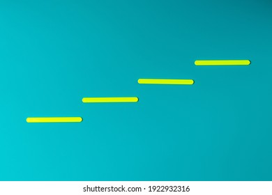 Yellow lines in the form of steps of stairs against the background of the color of sea water. Business growth concept