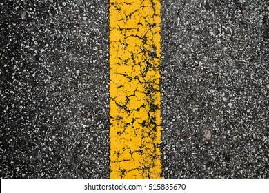 Yellow lines on asphalt texture/ background.