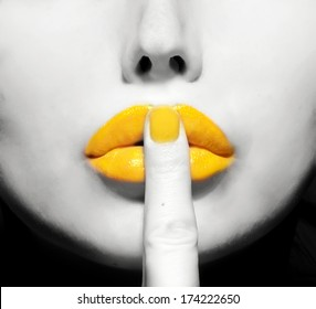yellow lips with finger on it close up